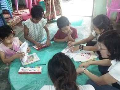 Kids drawing their dreams with crayon at orphanage near Yangon